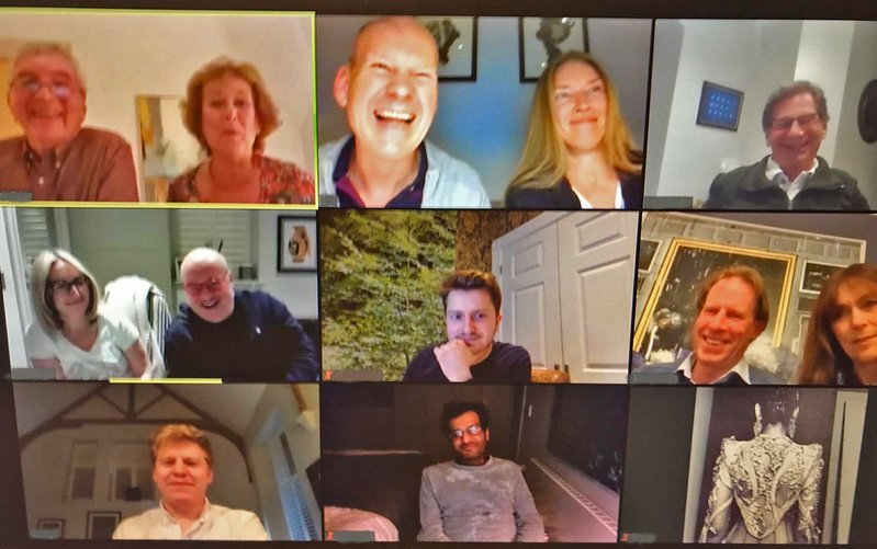Zoom Call with 9 participants shown.