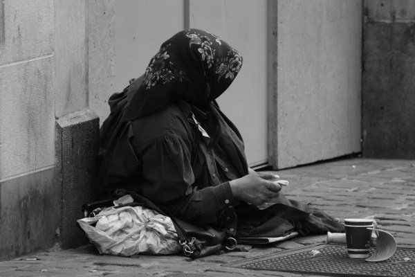 Poor person begging in the streets