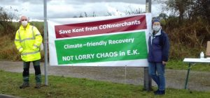 Protesters with banner - Save Kent from CONmerchants. Climate - friendly Recovery. Not Lorry Chaos in EK.