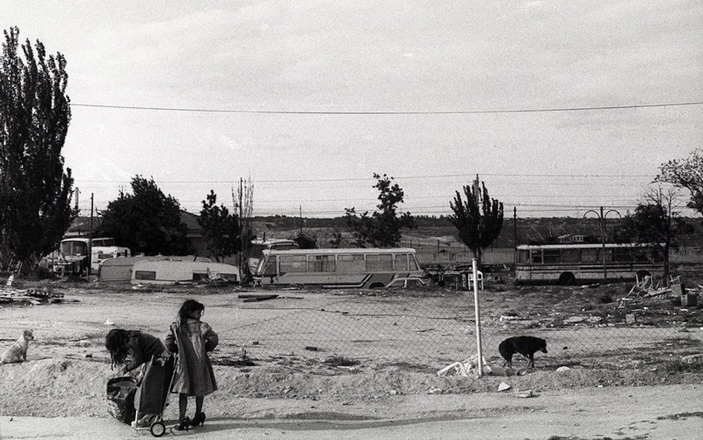Two young Gypsies in front of a derelict camping site