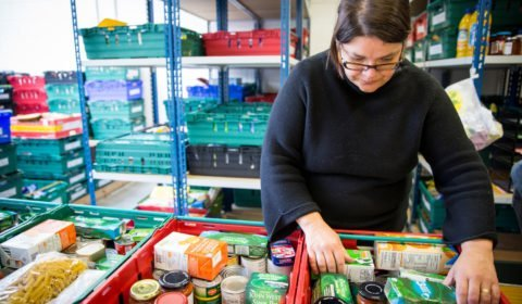 Volunteer sorting donations of food at Trussell Trust